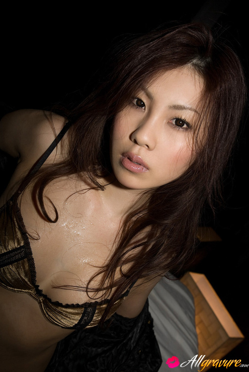 Beautiful asian model with oiled body