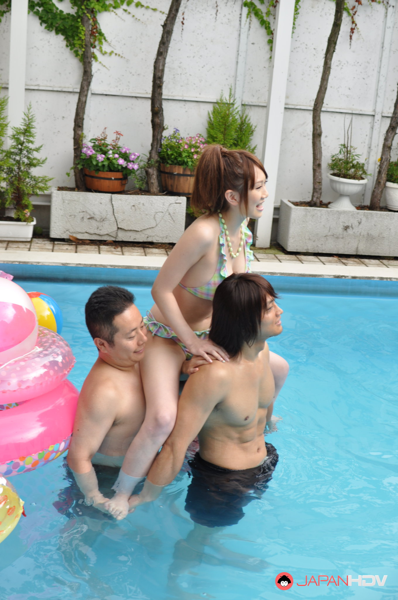 Japanese girls enjoy in some sexy pool party